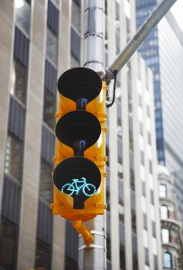 Cyclists in NYC have dedicated bike paths, and traffic signals.